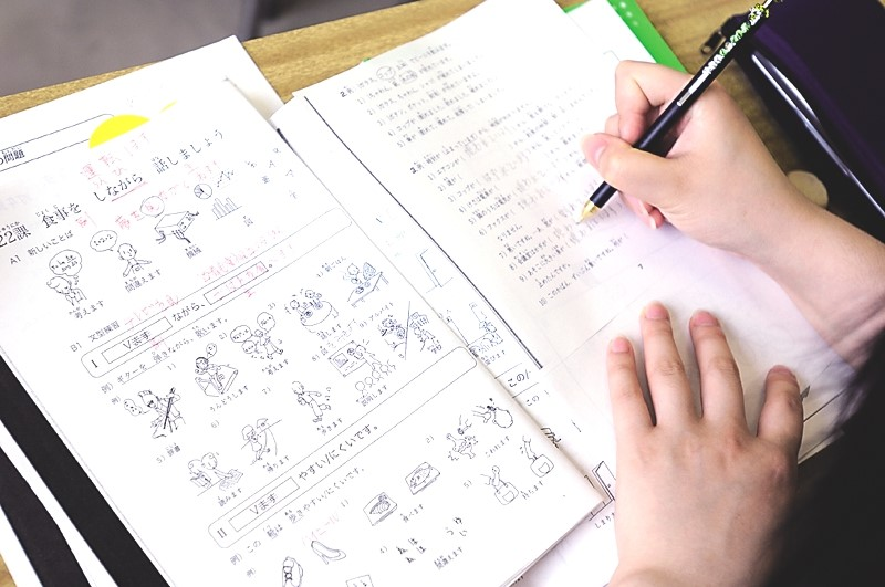 Elementary Japanese students practice verb conjugation.