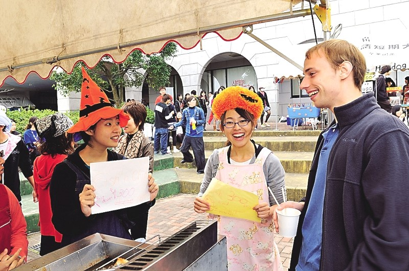 Japanese students sell fish 'n chips at the University Festival.