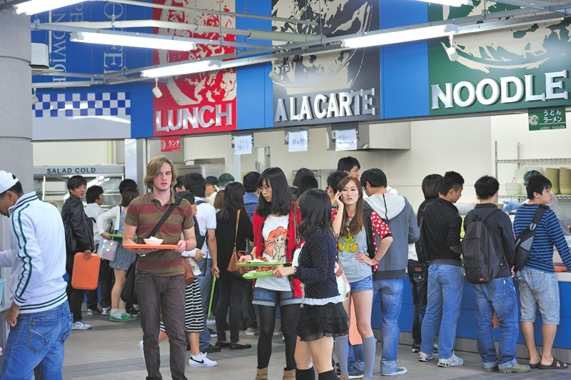 Students line up for curry, noodles, and the three daily specials.