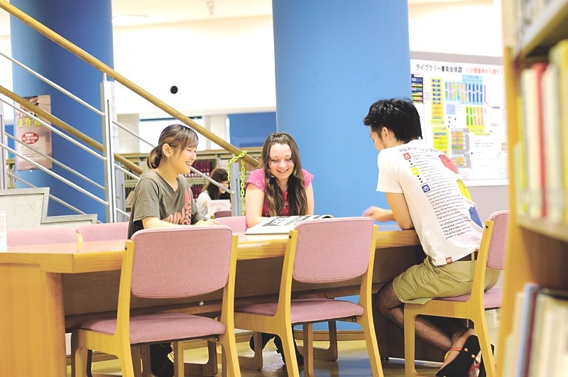 Students chat quietly in the library.