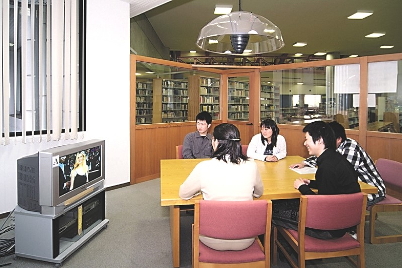 Students watch US television in the Worldwide Broadcast Center.