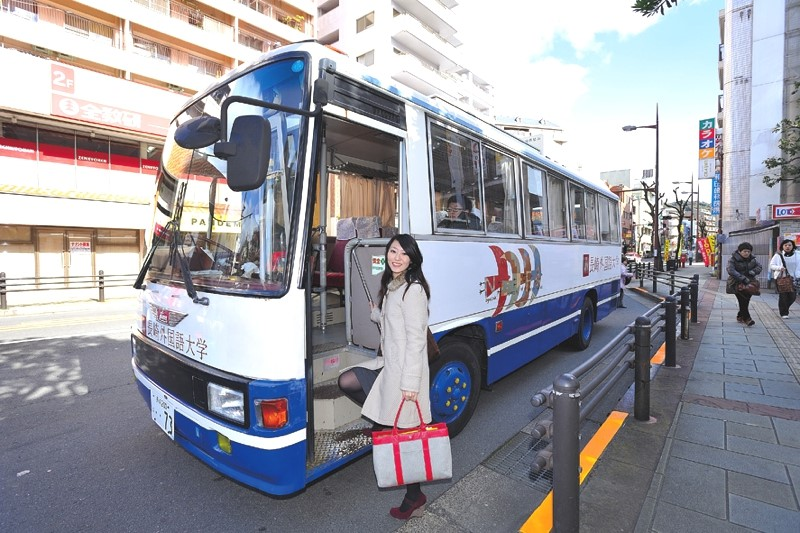 Student Yu Gotanta boards the free university bus for a 10-minute ride to school.