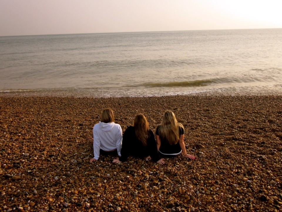 Watching the sunset on the pebbly beach in Brighton is a great way to end the day.