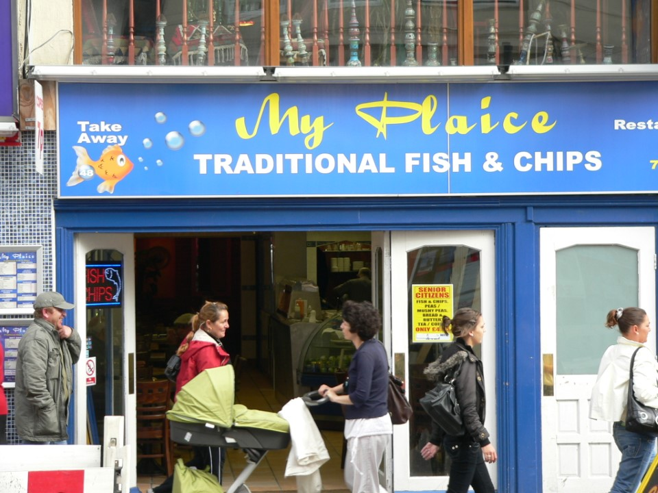 As you're walking through Brighton, have luch at a local fish & chips shop.