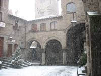 Medieval piazza San Pellegrino during a winter snow storm.