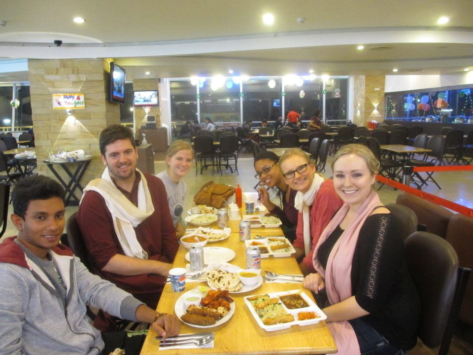 Students enjoying their first meal in India at a local shopping center near their housing. Bangalore is full of restaurants and shopping malls, and USAC student housing is located right in the center of the action.