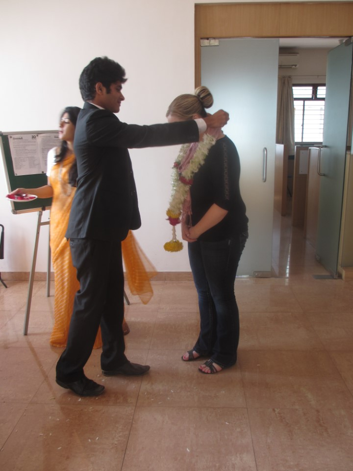 Each student receives this traditional Indian welcome; the flowers smell lovely. There is no shortage of hospitality in India.
