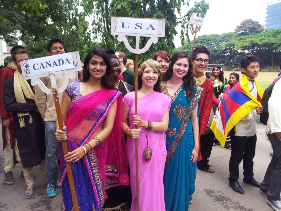 USAC students represent their home countries at the Ethnicity Day celebrations by carrying signs representing their home countries, in the Ethnicity Day Parade.