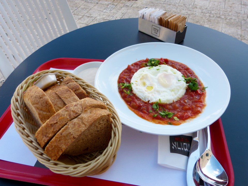 Shakshooka is a tomato based soup with onion and garlic. Oftentimes this dish can be found served right in the pan it was made in with two poached eggs on top.