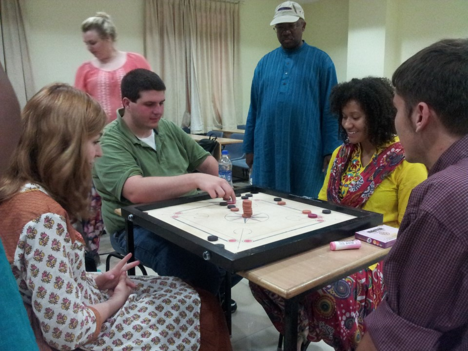 Playing a carom board game is a great way to get to know the culture -- and each other!