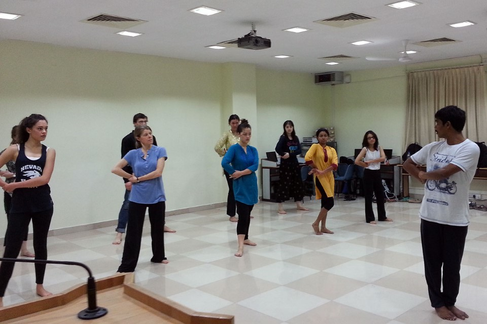 Christ University's dance professor is teaching USAC students the routine for their upcoming performance.