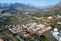 Aerial view of Stellenbosch with university housing in foreground.