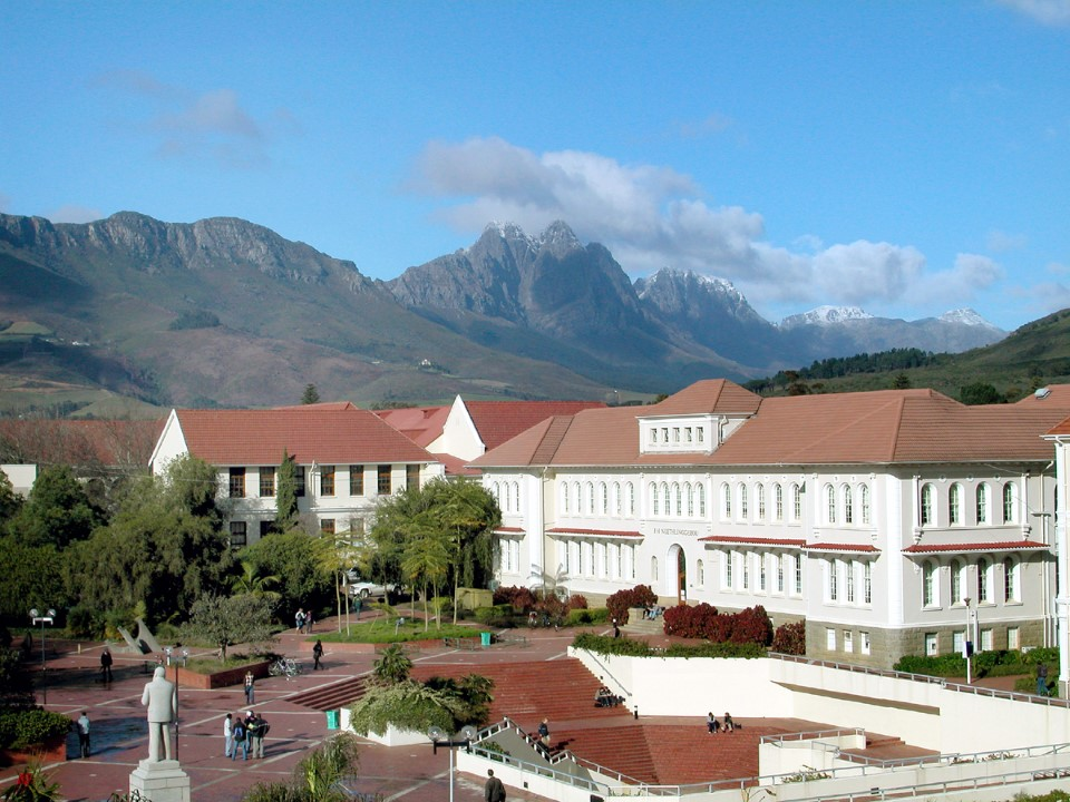 Stellenbosch University with snow-covered peaks in the background.