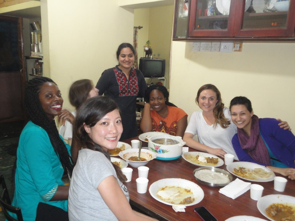Students enjoying an authentic Indian dinner witha host family
