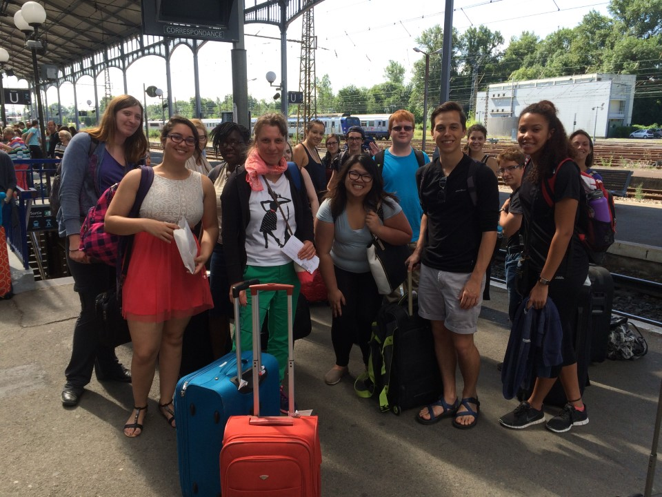 Robina taking the train from Pau to Paris with the Paris tour students