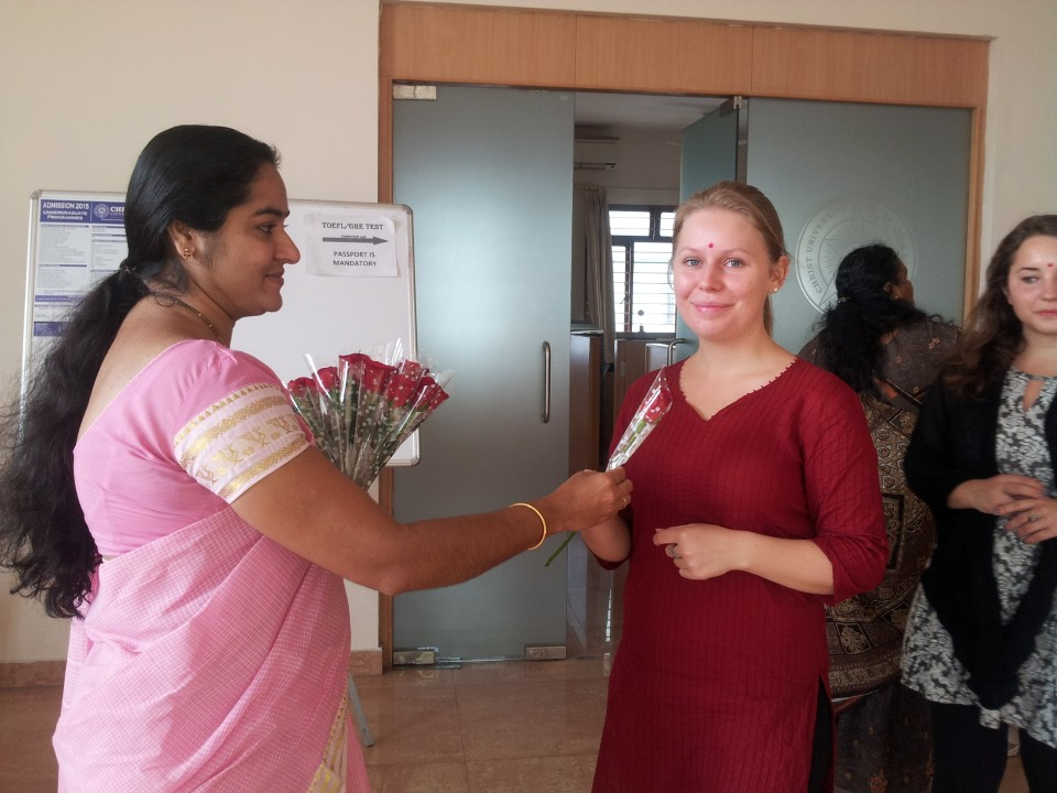 Seema, (on left) the Program Assistant in Bengaluru, is welcoming new students at orientation with flowers.