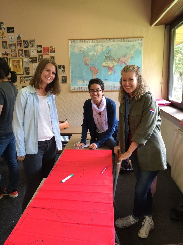 USAC students making red Phrygian caps, the symbol of liberty during the French Revolution