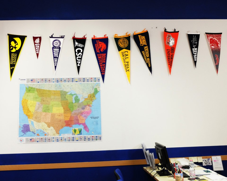 Pennants from students' home universities hang on the wall in the USAC office.