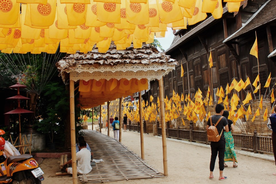 Buddhist flags hang near temples within the city of Chiang Mai.