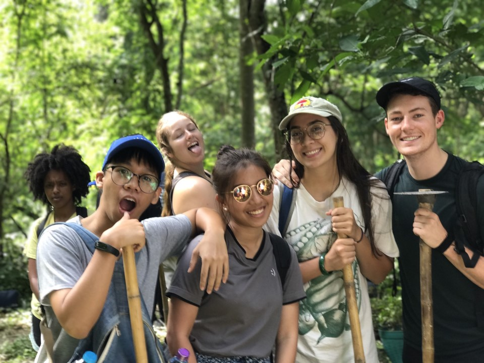Students participate in local reforestation efforts.