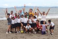 Playing soccer with local kids on the beach