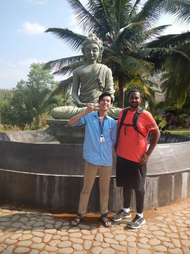 Students pose for a photo during a visit Pyramid Valley, a Buddhist meditation center, on a Buddhism and Hinduism in Contemporary Society class field trip