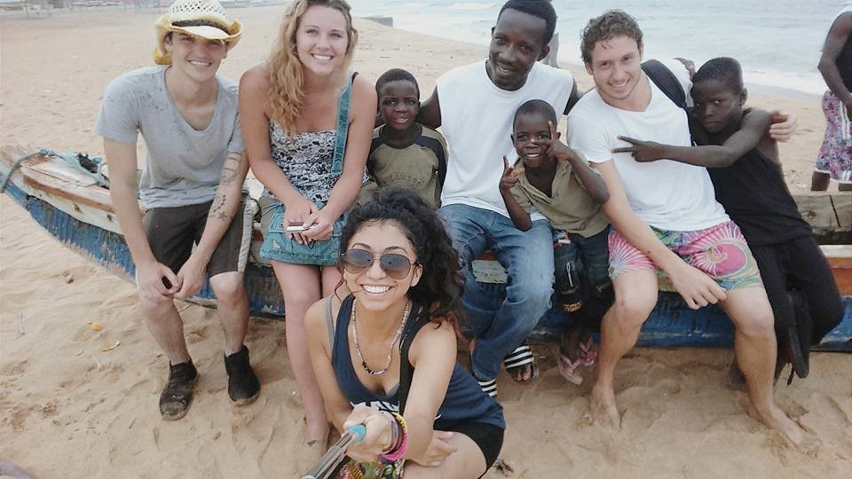 Students on the beach with locals