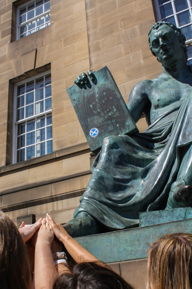 David Hume was a Scottish Enlightenment philosopher and it's said to be good luck to touch the shoe of his statue