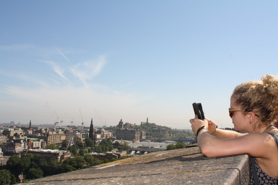 The Edinburgh skyline is a mixter of modern progress and ancient traditions