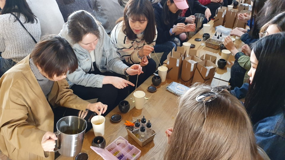 Learning how to make traditional Korean candles in Folk Village