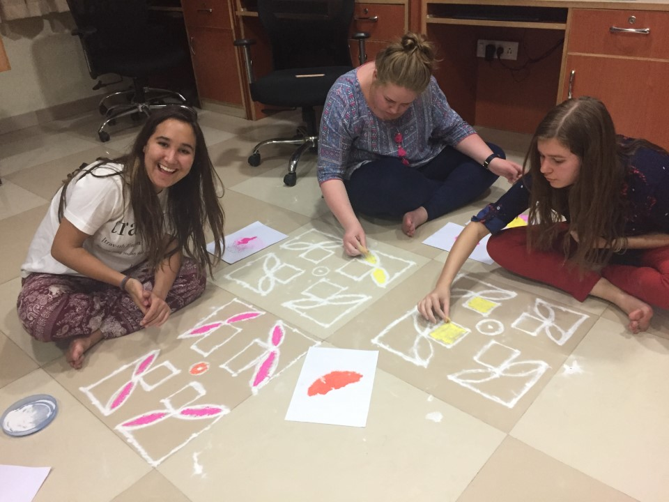 Students participate in Rangoli -an Indian art form