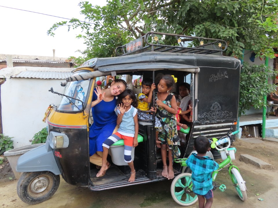 In a rickshaw with local kids