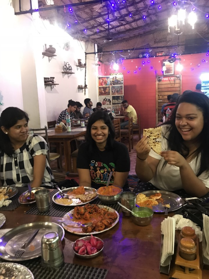 A group of students dine out together at a local restuarant in Bengaluru