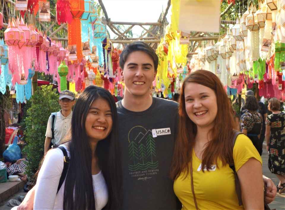 USAC student take a picture infront of Thai Northern lanterns in Chiang Mai.
