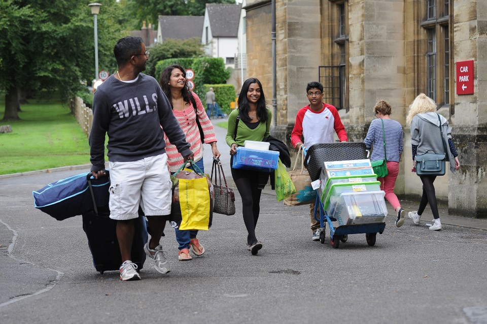 Student and family arriving with luggage at Wills Hall during moving-in day