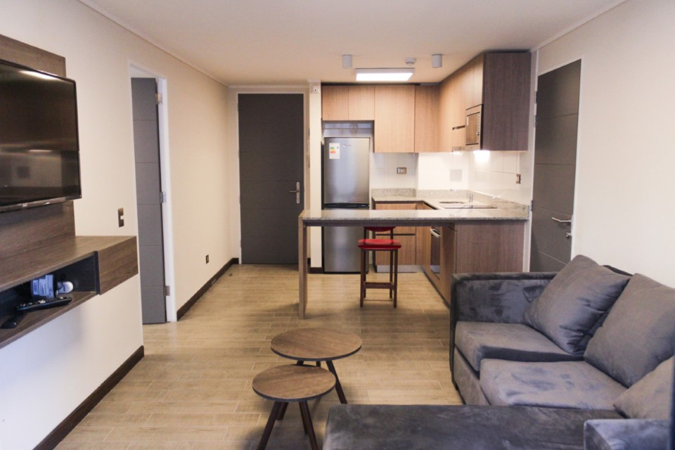 Kitchen and living room in Santiago's International Housing facility.