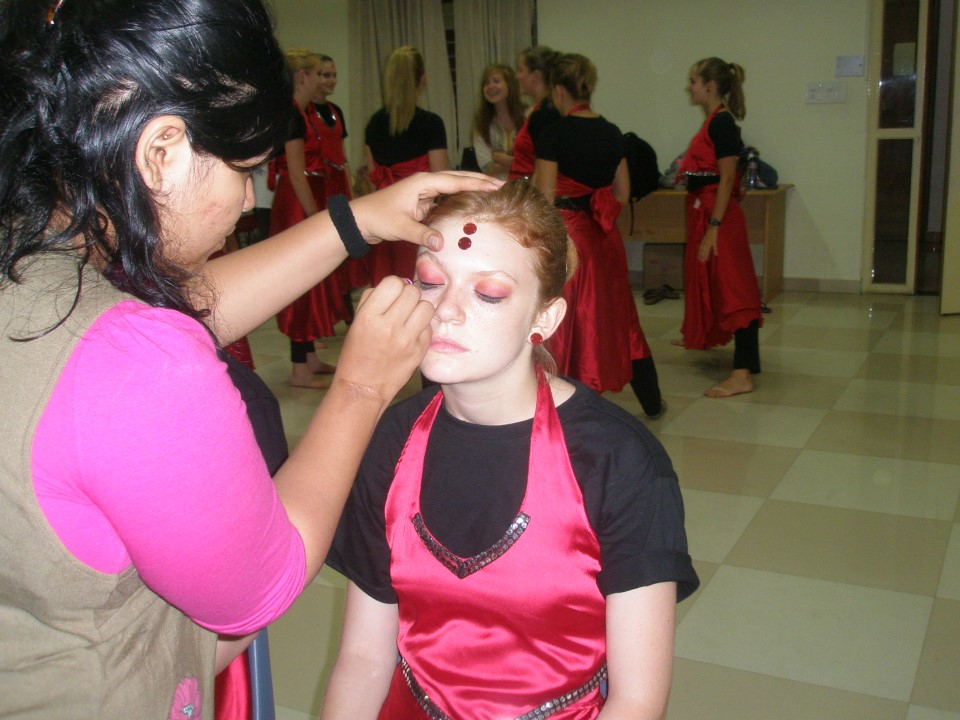 Christ University students helped the girls apply makeup before the performance.